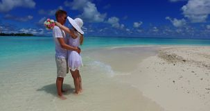 V07480 Maldives white sandy beach 2 people a young couple man woman standing together in love on sunny tropical paradise Royalty Free Stock Images