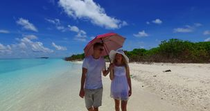 V07510 Maldives white sandy beach 2 people a young couple man woman walking together in love on sunny tropical paradise. Maldives white sandy beach 2 people a stock footage
