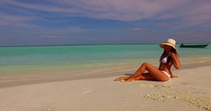 V07857 Maldives white sandy beach 1 person young beautiful lady sunbathing alone on sandbar on sunny tropical paradise. Maldives white sandy beach 1 person young stock video footage