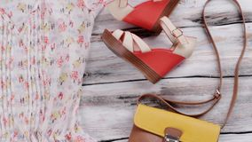 V-neck blouse and wedge sandals. Red wedge shoes with bag. Girl's comfortable summer outfit. Special prices in boutique stock video