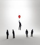 Vôo abstrato minúsculo do homem afastado em um balão Imagem de Stock Royalty Free