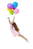 Vôo da menina com balões imagens de stock royalty free