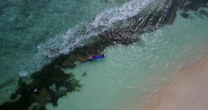 V09371 People enjoying boats and watersports with view from aerial flying drone in clear aqua blue sea water and blue. People enjoying boats and watersports with Stock Photography