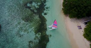 V09335 People enjoying boats and watersports with view from aerial flying drone in clear aqua blue sea water and blue Stock Photography