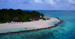 V12866 resort in maldives white sand beach tropical islands with drone aerial flying birds eye view with aqua blue sea. Resort in maldives white sand beach stock video footage