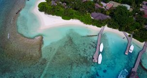 V12944 resort in maldives white sand beach tropical islands with drone aerial flying birds eye view with aqua blue sea. Resort in maldives white sand beach stock video