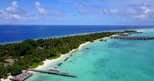V12927 resort in maldives white sand beach tropical islands with drone aerial flying birds eye view with aqua blue sea. Resort in maldives white sand beach stock video footage
