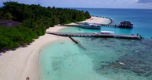 V12905 resort in maldives white sand beach tropical islands with drone aerial flying birds eye view with aqua blue sea. Resort in maldives white sand beach stock video