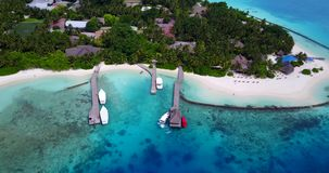V12900 resort in maldives white sand beach tropical islands with drone aerial flying birds eye view with aqua blue sea. Resort in maldives white sand beach stock video footage