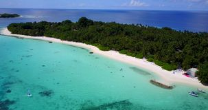 V12929 resort in maldives white sand beach tropical islands with drone aerial flying birds eye view with aqua blue sea. Resort in maldives white sand beach stock footage