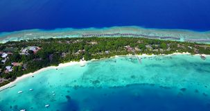V12856 resort in maldives white sand beach tropical islands with drone aerial flying birds eye view with aqua blue sea. Resort in maldives white sand beach stock video footage