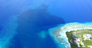 V12947 resort in maldives white sand beach tropical islands with drone aerial flying birds eye view with aqua blue sea. Resort in maldives white sand beach stock video footage