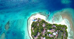 V12875 resort in maldives white sand beach tropical islands with drone aerial flying birds eye view with aqua blue sea. Resort in maldives white sand beach stock footage