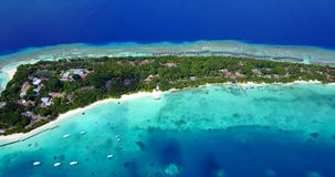 V12854 resort in maldives white sand beach tropical islands with drone aerial flying birds eye view with aqua blue sea. Resort in maldives white sand beach stock footage