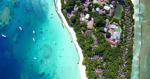 V12873 resort in maldives white sand beach tropical islands with drone aerial flying birds eye view with aqua blue sea. Resort in maldives white sand beach stock footage