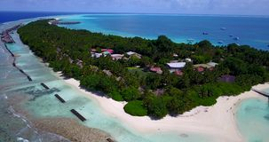 V12912 resort in maldives white sand beach tropical islands with drone aerial flying birds eye view with aqua blue sea. Resort in maldives white sand beach stock video