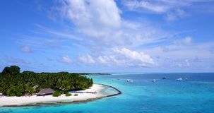 V12867 resort in maldives white sand beach tropical islands with drone aerial flying birds eye view with aqua blue sea. Resort in maldives white sand beach stock video