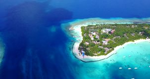 V12948 resort in maldives white sand beach tropical islands with drone aerial flying birds eye view with aqua blue sea. Resort in maldives white sand beach stock footage
