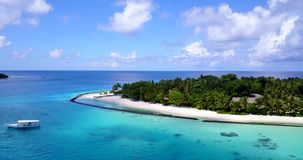 V12853 resort in maldives white sand beach tropical islands with drone aerial flying birds eye view with aqua blue sea. Resort in maldives white sand beach stock footage