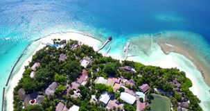 V12884 resort in maldives white sand beach tropical islands with drone aerial flying birds eye view with aqua blue sea. Resort in maldives white sand beach stock video footage