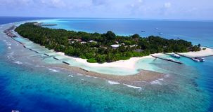 V12915 resort in maldives white sand beach tropical islands with drone aerial flying birds eye view with aqua blue sea Royalty Free Stock Images