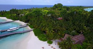 V12943 resort in maldives white sand beach tropical islands with drone aerial flying birds eye view with aqua blue sea Stock Photography