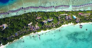 V12872 resort in maldives white sand beach tropical islands with drone aerial flying birds eye view with aqua blue sea Royalty Free Stock Images