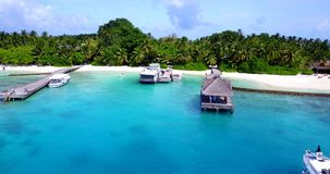 V12892 resort in maldives white sand beach tropical islands with drone aerial flying birds eye view with aqua blue sea Stock Image