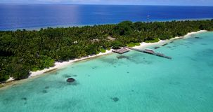 V12928 resort in maldives white sand beach tropical islands with drone aerial flying birds eye view with aqua blue sea Royalty Free Stock Photo