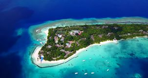 V12952 resort in maldives white sand beach tropical islands with drone aerial flying birds eye view with aqua blue sea Stock Photos