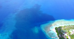 V12947 resort in maldives white sand beach tropical islands with drone aerial flying birds eye view with aqua blue sea Stock Photos