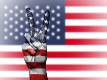 V sign and American flag Royalty Free Stock Photography