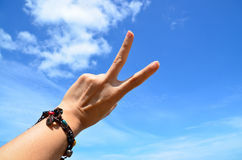 V-sign. With blue sky background Stock Image