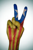 V sign patterned with the Catalan pro-independence flag Royalty Free Stock Photo