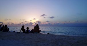 V12785 sunset sunrise group of young beautiful girls on beach with drone aerial flying view of evening morning clear sea Royalty Free Stock Images