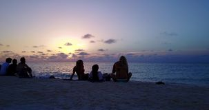 V12783 sunset sunrise group of young beautiful girls on beach with drone aerial flying view of evening morning clear sea Royalty Free Stock Photography