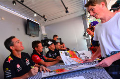 V8 Supercars champion drivers meet Motorsport fans in Auckland,. AUCKLAND - NOV 05 2015:V8 Supercars champion driver Craig Lowndes (L) sign autographs for royalty free stock photography