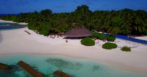 V12841 swimming pool in maldives hotel resort with white sand beach tropical islands with drone aerial flying birds eye. Swimming pool in maldives hotel resort stock footage