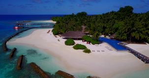 V12835 swimming pool in maldives hotel resort with white sand beach tropical islands with drone aerial flying birds eye stock video footage