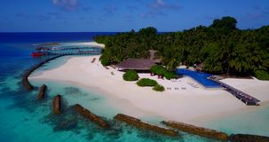 V12834 swimming pool in maldives hotel resort with white sand beach tropical islands with drone aerial flying birds eye stock footage