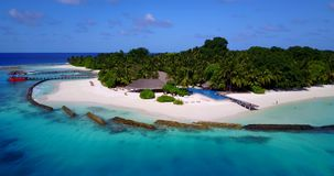 V12830 swimming pool in maldives hotel resort with white sand beach tropical islands with drone aerial flying birds eye Royalty Free Stock Photos