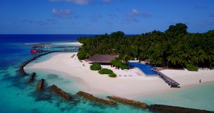 V12833 swimming pool in maldives hotel resort with white sand beach tropical islands with drone aerial flying birds eye Stock Image