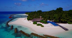 V12834 swimming pool in maldives hotel resort with white sand beach tropical islands with drone aerial flying birds eye Stock Photo