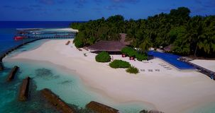 V12836 swimming pool in maldives hotel resort with white sand beach tropical islands with drone aerial flying birds eye Stock Photos