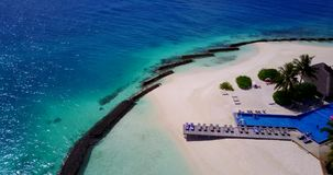 V12828 swimming pool in maldives hotel resort with white sand beach tropical islands with drone aerial flying birds eye Royalty Free Stock Image