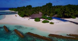 V12838 swimming pool in maldives hotel resort with white sand beach tropical islands with drone aerial flying birds eye Stock Photo