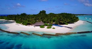 V12850 swimming pool in maldives hotel resort with white sand beach tropical islands with drone aerial flying birds eye Royalty Free Stock Image