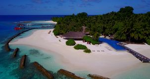 V12835 swimming pool in maldives hotel resort with white sand beach tropical islands with drone aerial flying birds eye Royalty Free Stock Image