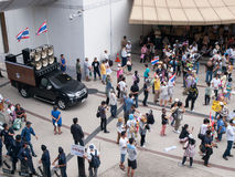 V for Thailand. Anti-government protesters wearing masks in Bangkok's shopping district on June 30, 2013 in Bangkok, Thailand. The protesters are calling for the Royalty Free Stock Photo