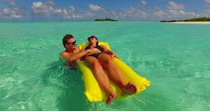 V13903 two 2 people inflatable sunbed romantic young people couple with drone aerial flying view on a tropical island of Royalty Free Stock Photo